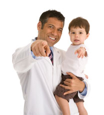 Doctor holding little boy