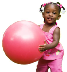 2 year old playing with big ball