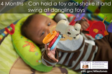Can hold a toy and shake it and swing at dangling toys