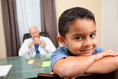 Boy in a doctor's office facing backwards in his chair