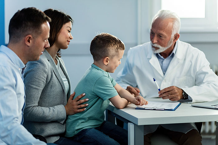 Boy with his parents at doctor's appointment