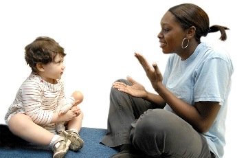 Photo: Teacher using sign language with a child