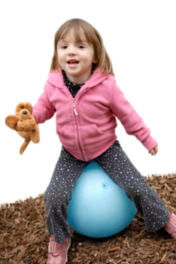 Photo: Child bouncing on large ball