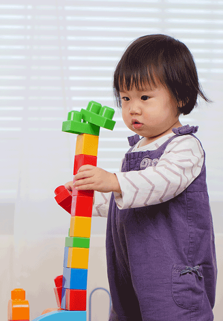 Asian girl stacking blocks