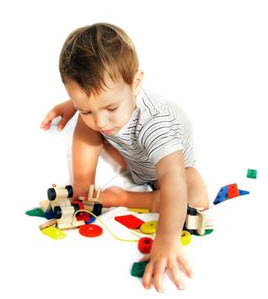 Photo: Child playing with toys