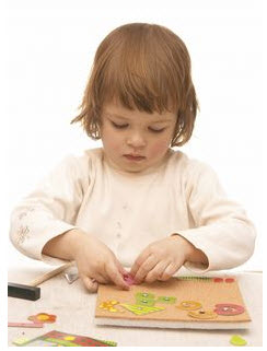 Photo: Child playing with puzzle