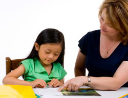 Photo: child working with adult