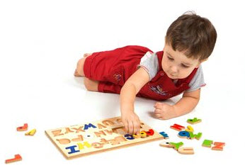 Photo: Child playing with a puzzle