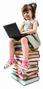 Photo: girl sitting a stack of books playing on a computer