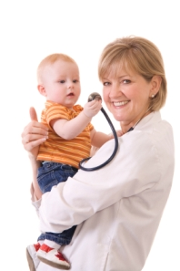 Photo: Physician holding child