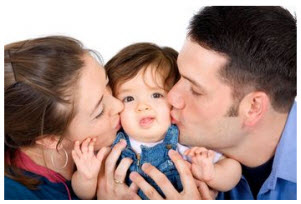 Photo: Family kissing child
