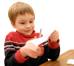 Photo: Boy cutting paper