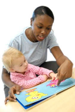 Photo: Woman reading to child