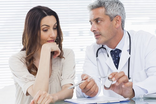 Woman culting with doctor