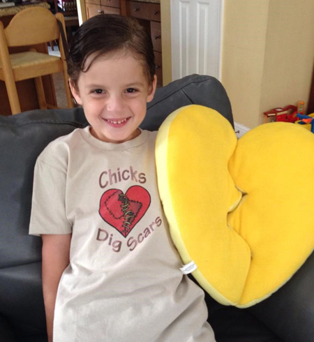 Caden holding a stuffed heart