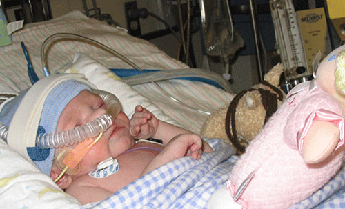Piper in the hospital as an infant