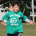 Nicholas playing soccer
