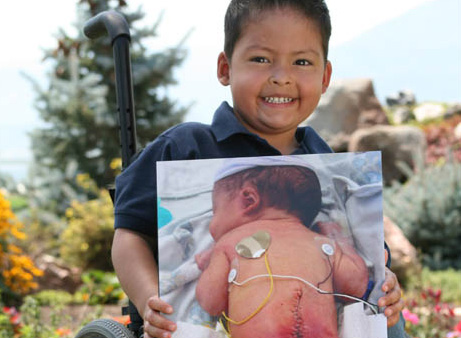 Zach holding a picture of him as an infant.