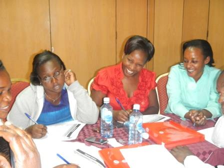 Picture of Field epidemiology staff training a nurse on diagnosis and coding
