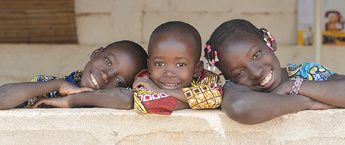 Three Adorable African Children Posing Outdoors