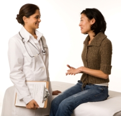 Woman discussing issues with physician