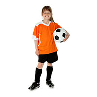 School aged child holding a soccer ball