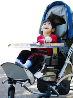 boy in blue wheelchair
