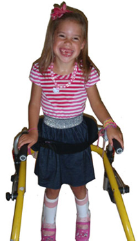 child walking with a walker