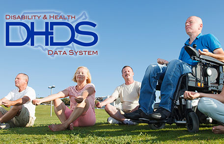 Adults doing yoga in a park, one of them in a wheelchair. Disability and Health Data System logo included at the top.