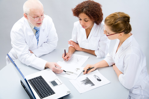 Doctors reviewing data.
