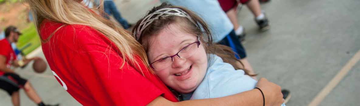 Photo of special olympics participant hugging a woman