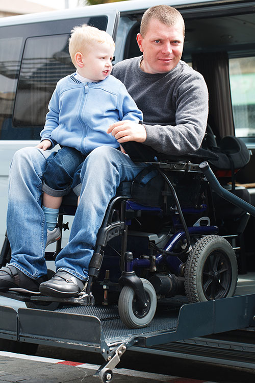 Disabled Men with son on Wheelchair