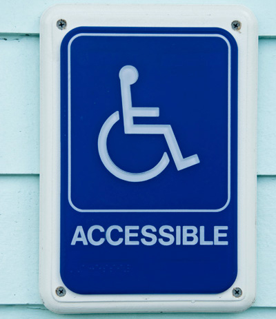 Accessible street sign with wheelchair logo