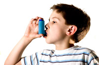 Young boy with inhaler