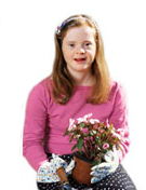 A young girl with down syndrome holding flowers