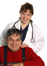 Doctor standing behind a man with her hands on his shoulders