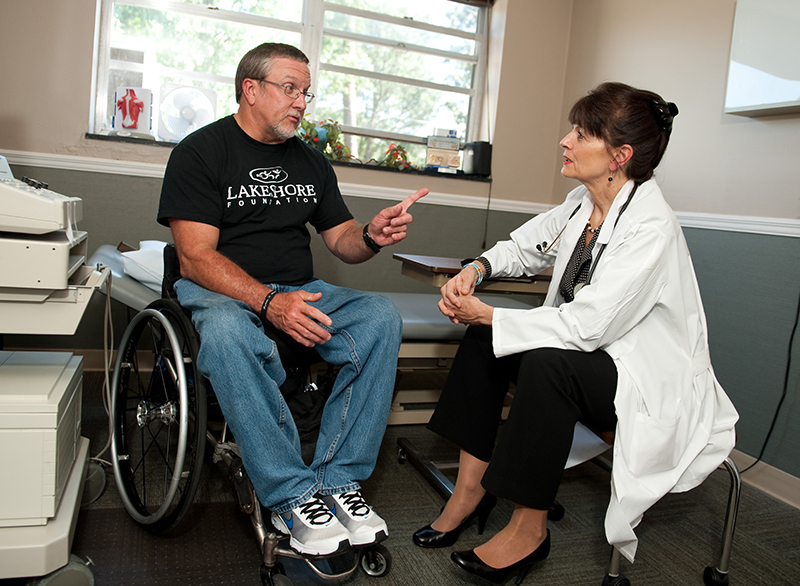 Photo: Jerry talking with his doctor