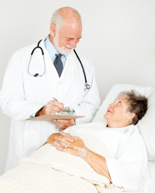 Doctor talking with patient and taking notes.