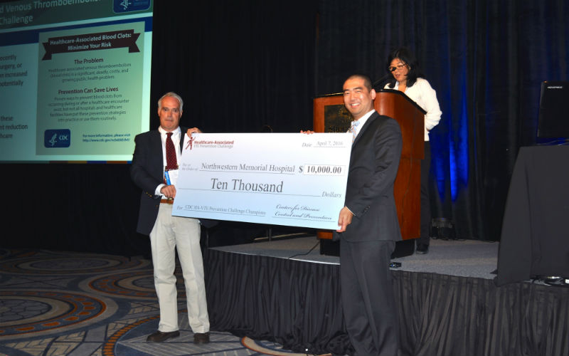 Photo of Division of Blood Disorders Director Dr. Craig Hooper presenting $10,000 award to Northwestern Memorial Hospital