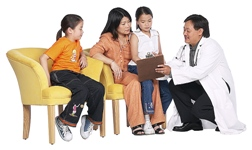 A doctor talking to a mom and two children