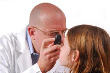 doctor looking at girls eyes