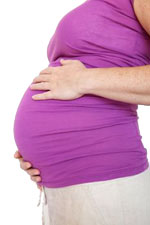 Pregnant woman in pink shirt