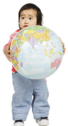 Toddler holding a globe