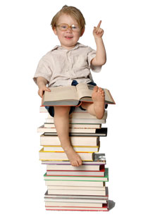 Child sitting on stack of articles