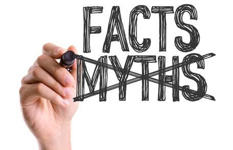 Hand with pen crossing out myths and showing facts
