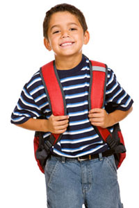 hispanic boy with school backpack