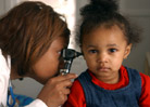 Doctor looking in a child's ear.