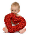 Baby with a heart shaped rose bouquet
