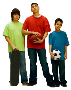 Boys (11-14) standing together with sports equipment