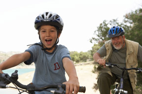 Grandson and grandfather bicycling